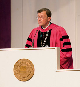 Garner presides over graduation each year in his crimson robes symbolizing his Ph.D. from Harvard University. (Photo by Jeff Schmatt)