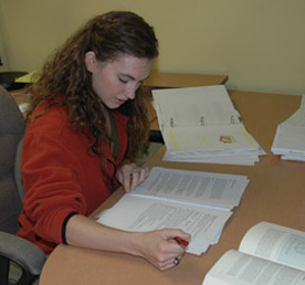 Jenelle working on a manuscript