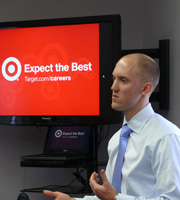 Aaron Reykdal '06 landed a job at Target after his Cornell Fellowship there. He returned last fall to talk to students about life after college. (Photo by R.J. Holmes-Leopold)