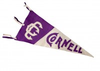 Cornell Pennant: There are a lot of ways to show support for your alma mater, and one of the most visible is a college pennant like this one from the 1920s. The triangular flag, descended from the ways ships once signaled each other, is now a signal of loyalty to Cornell. And the pennant is still going strong—admitted students get a pennant with their acceptance letters, and dozens of alumni have participated in the Purple Pennant Project, taking photos of themselves with a Cornell pennant in places around the world.