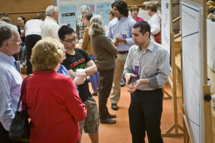 Gibran Nasir explains his research project at the Student Symposium (Credit: Mehrdad Zarifkar '09)