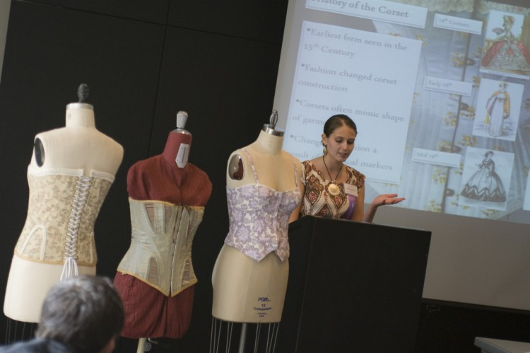 "Olivia Cotton '13 delivers her Student Symposium presentation  ""Unlacing the Corset: A Look into the History and Construction of Fashion's Most Contentious Garment."" She graduated several weeks  later with a major in mathematics and a minor in biology. (Credit: Mehrdad Zarifkar '09)"