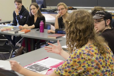 Margo Fritz contributes to the discussion in the creative writing course taught by visiting writer Sandra Beasley (left).