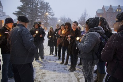 The Rev. Richard Thomas gathers with current students in January to honor Martin Luther King Jr. and Nelson Mandela and to reflect on their contributions to freedom and equality during MLK week at Cornell. Tiffany Monreal '14