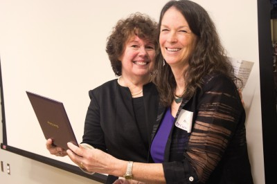 Sally Farrington-Clute receives her honorary alumna certificate from Sheila Kruse-Boyce '85, past president of the Cornell College Alumni Association and former Farrington-Clute advisee.