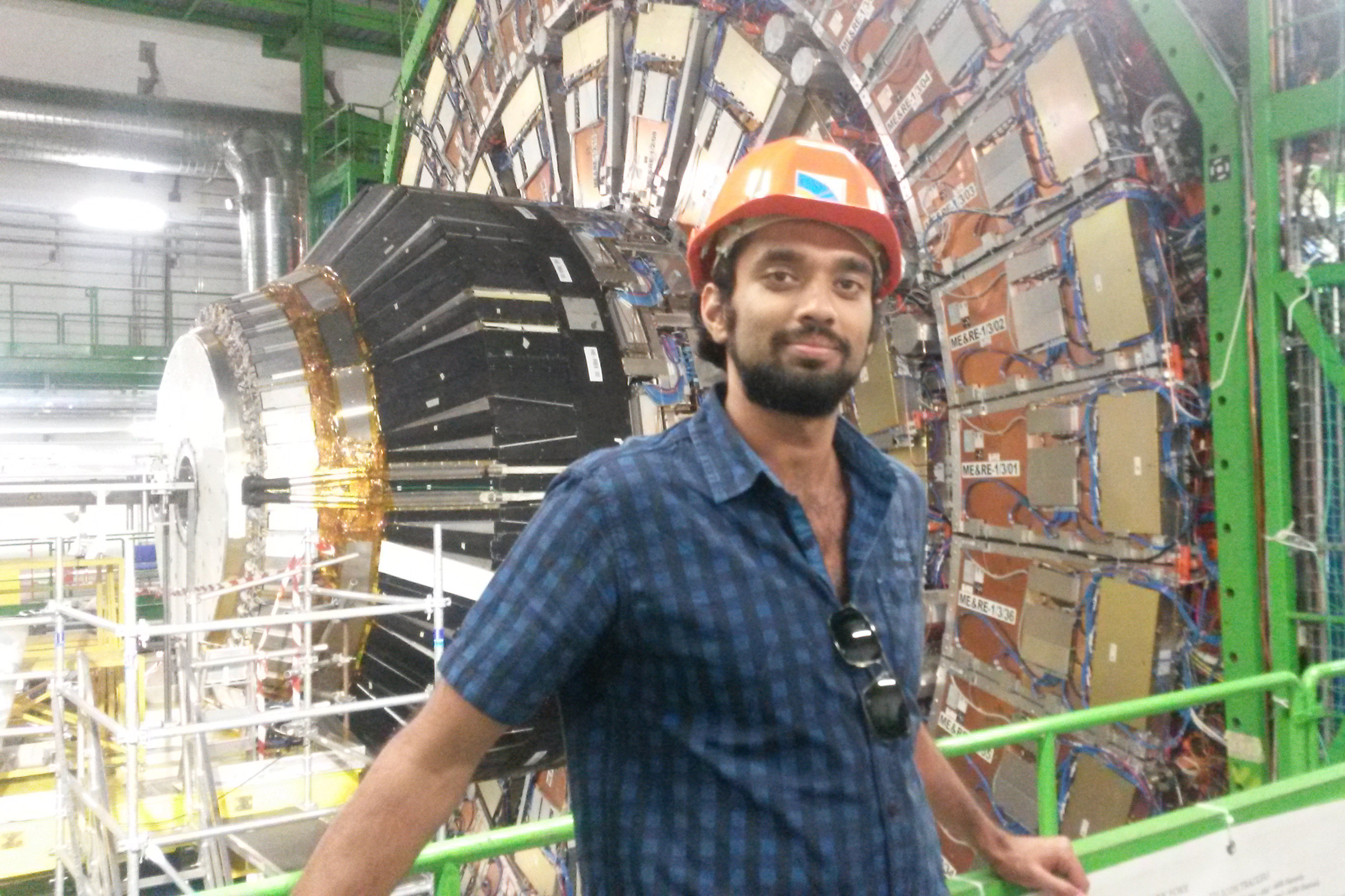 Raghav Kunnawalkam Elayavalli '11 in front of the Compact Muon Solenoid experiment,  one of two large general-purpose particle physics detectors built on the Large Hadron Collider.