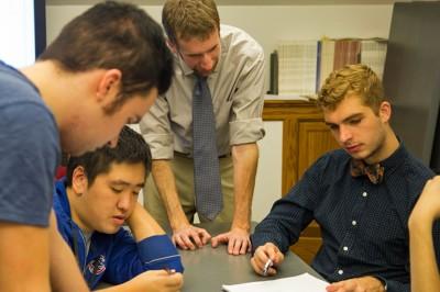 Professor Hans Hassell works with students during Campaigns & Elections
