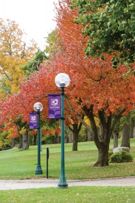 Vivid fall colors and festive Cornell banners combine to make the central entrance to campus especially welcoming. Robyn Schwab Aaron '07