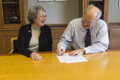 Cornell College Dean Joe Dieker and University of Iowa College of Law Dean Gail Agrawal sign the 3+3 agreement between the two schools.