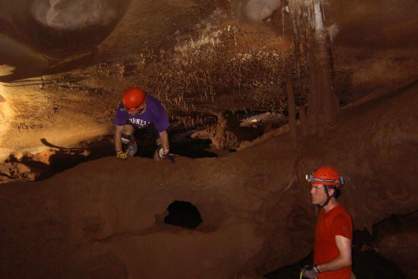 Rhawn Denniston (right), professor of geology at Cornell College, with Dan Cleary '13, a member of his student research team, examining stalagmites in an Australian cave.
