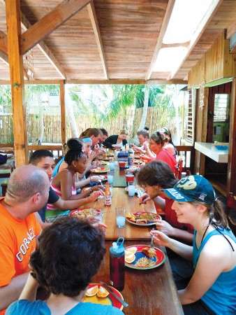 Cornell anthropology and biology students enjoy lunch at the International Zoological Expedition field station in South Water Caye, Belize.  Photo by Craig Tepper
