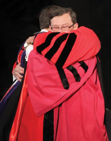 President Brand hugs President Garner after being presented with the keys to College Hall as a symbol of office.