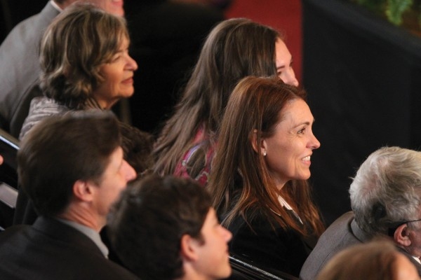 Rachelle LaBarge, wife of Jonathan Brand, enjoys the ceremony with family.