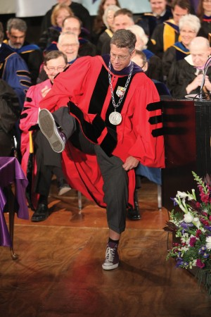 During his inaugural address, President Brand displays his purple Converse Chuck Taylor All-Stars to illustrate his passion for playfulness