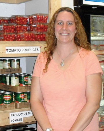 After receiving a master's degree in social work, Tina Effner DuBois '99 became the executive director of the North Liberty Community Pantry, now recognized as a model for others around the nation and the world (Photo by Tina Effner DuBois '98)