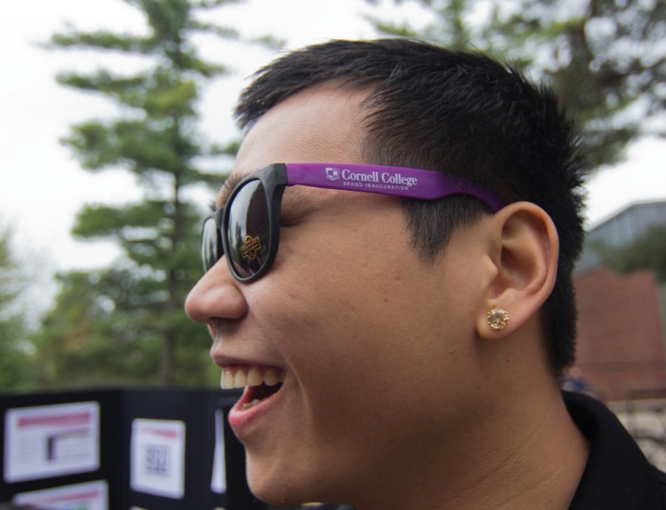 A student happily sports the inaugural sunglasses given out during the Student Street Fair