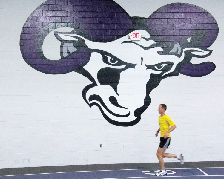 """Running is easy... cancer is hard."" Volleyball coach Jeff Meeker (Photo by Jamie Kelly)"