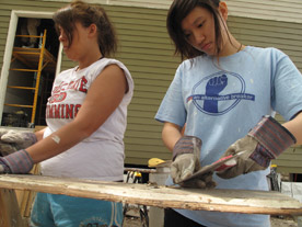Each year, dozens of students take part in Alternative Spring Break, and spend a week in March in service to others. In 2009 and 2010, students went to New Orleans to help repair damage from Hurricane Katrina (Photo by Tom Javoroski)