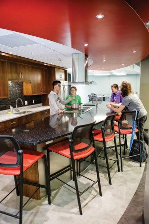 Students engage in conversation in Dows Hall's industrial-grade kitchen. Photo by Robyn Schwab Aaron '07