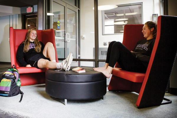 Students unwind in the renovated lounge of Dows Hall. Photo by Robyn Schwab Aaron '07