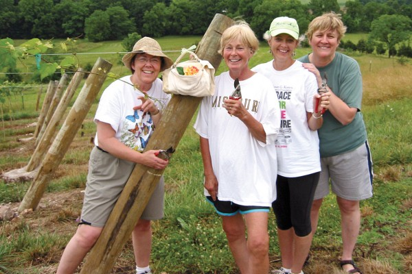 "Chris ""Jenna"" Hanus Hiratzka '73, Ann Carbee Jones '73, Michele Merrell Bryan '71, and Ginger Soper Smith '73 (from left) with The Cursed Purse, taken in 2005 at Ann's vineyard near Jefferson City, Missouri."