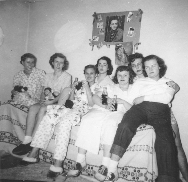 Helga Koch Konopacki '50 (second from left) and her friends and roommates in Pfeiffer Hall enjoying Cokes and knitting.