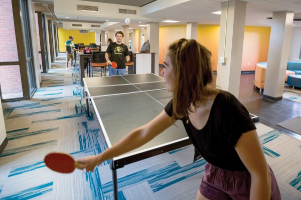 Students play ping-pong and billiards in Pauley-Rorem Hall. Photo by Robyn Schwab Aaron '07