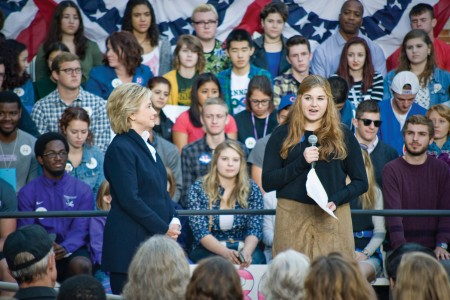 Sophie Meads '19 introduces Hillary Clinton to hundreds of voters at a town hall meeting outside of College Hall.