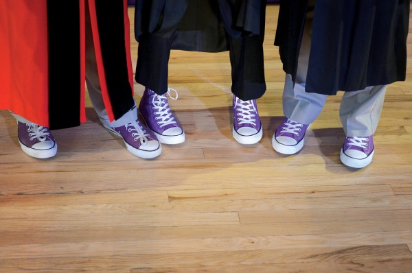 Cornell President Jonathan Brand (from left) and trustees Judy Hesler Jorgensen '60 and Robert McLennan '65 show off their purple Converse Chuck Taylor All-Stars after Homecoming Convocation on Oct. 10. Jorgensen was given the Distinguished Achievement Award, and McLennan received a Leadership and Service Award