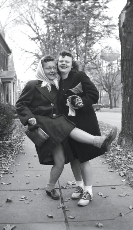 "Grace Larsen '50 (left) and Marilyn ""Maril"" Maurath '50 enjoy a light moment in uptown Mount Vernon. The water tower has been replaced but the building at left is still in operation as the Perfect Blend."