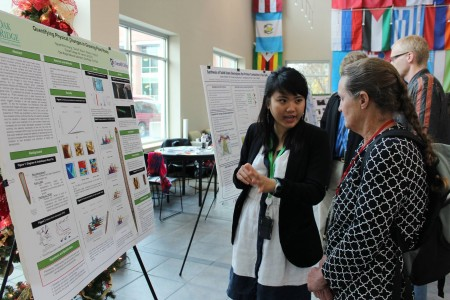Nguyet-Minh (Julie) Hoang '16 explains her poster to Sally Meyer, professor of chemistry at Colorado College, who is the faculty director at the Oak Ridge Science Semester.