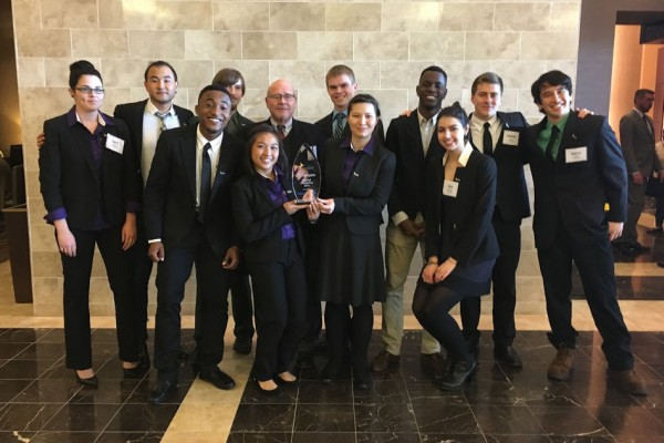 Cornell's Enactus team, left to right: April Richards, Hwi Ram Jeong, Abubakar Shehu, Nigel Tichnor, Anh Pham, Enactus advisor Tom Simon, Ryan Anderson, Robin Bridgman, Husani Newbold, Zara Anderson, Gabe Flippo, and Salem Osaki.