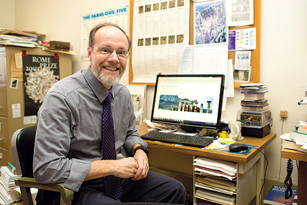 Classics Professor John Gruber-Miller is building a time machine.