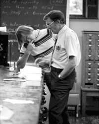 Chemistry Professor Bill Deskin works with a student in the Chemistry Building (now Norton Geology Center) (Photo by Eric Weston '79)