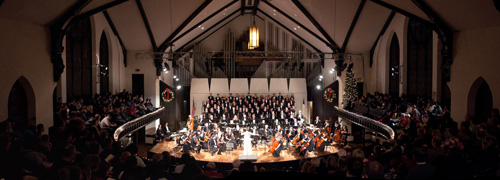 The combined concert choir and orchestra fill King Chapel's stage to perform John Rutter's Magnificat during the 2010 holiday concert.