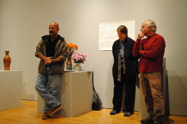 "About 25 alumni exhibited their art as part of the ""Doug Hanson Legacy"" show in October. Here, Hanson stands with David Rega '77 and Leila Denecke '72. Photo by Tiffany Monreal '14"