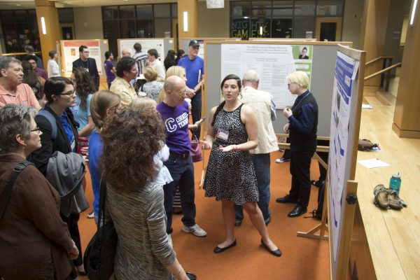 Shashanna Moll '17 discusses her poster presentation at the 20th annual Student Symposium (Photo by Jessica Meis '19)