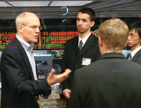 Students in Professor Chris Conrad's Financial Management Seminar course spent three days in Chicago in February. One day was dedicated to the Chicago Board Options Exchange. Pictured are juniors Andre DeSouza and Khol Luu talking with former CBOE trader and current instructor of the Options Institute, Jimm Bittman. (Photo by Frank Dixson '10)