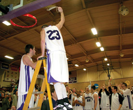 Seniors Griffin LaDew and Michael Tierney cut down the nets after defeating Wartburg 58-56 in the HAC Championship game. (Photo by Blake Rasmussen '05)