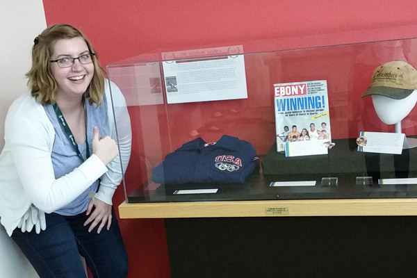 Amy Harrison '18, the Stimson Fellow in Museum Studies, with a small exhibit she curated at the African American Museum of Iowa.