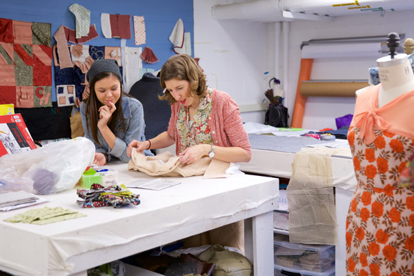 Theatre lecturer and costume shop su[ervisor Jenny Kelchen (right) works with students in her Costume Construction class. (Photo by Allan Recalde)