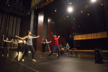 Alvon Reed and dancers on Kimmel Theatre stage.