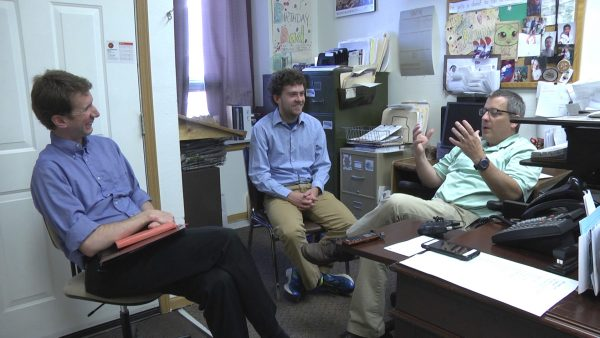 Professor Hans Hassell and Zach Stoll '18 meet with Jake Krob
