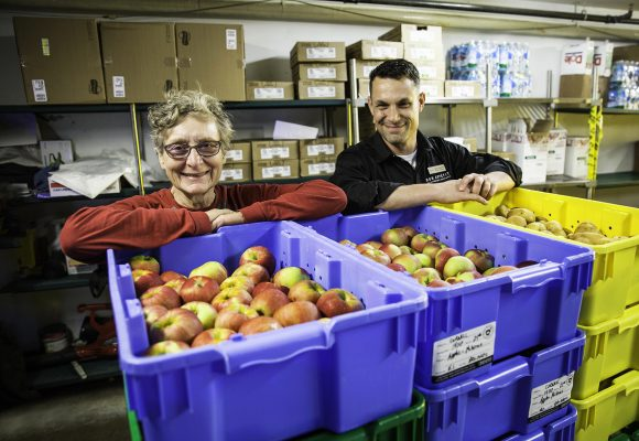 Mary Zahradnik of Buffalo Ridge Orchard delivers apples to Bon Appétit General Manager James Richards