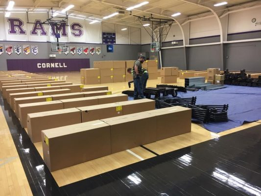 Picture of crews delivering new bleachers for the gym