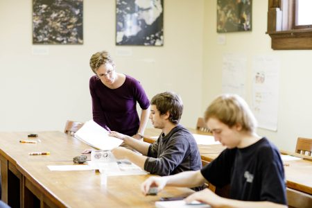Professor Emily Walsh works with students