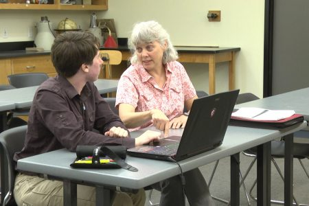 Picture of Professor Kara Beauchamp working with Marshall Hobson-Ritz