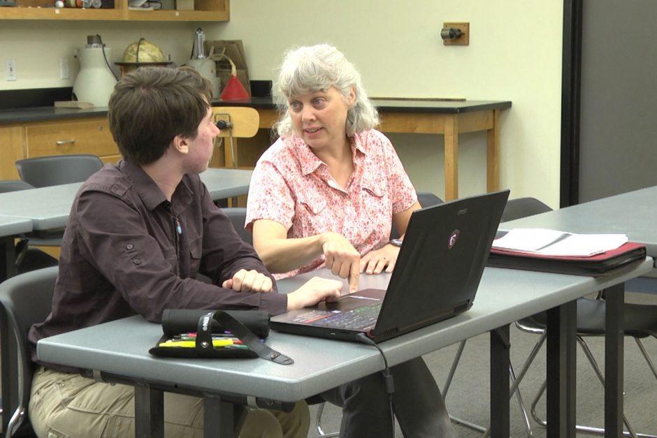 Picture of Professor Kara Beauchamp working with Marshall Hobson-Ritz