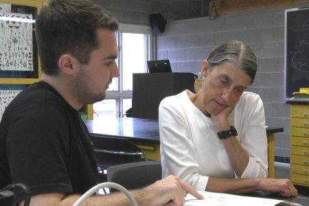 Professor Condon and Ben Garcia '19 looking at data