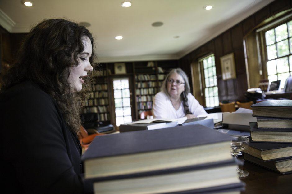 Maureen Sullivan '18, Emma Jean Meyer '19, Jessica Halter '18 , and Professor Leslie Kathleen Hankins work in the Van Etten-Lacey House. 11